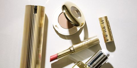 Metal, Tints and shades, Cosmetics, Material property, Silver, Paper, Personal care, Brand, Cylinder, Paper product,