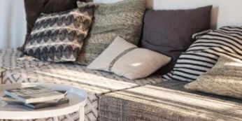Brown, Property, Room, Furniture, Table, White, Interior design, Living room, Pillow, Couch,