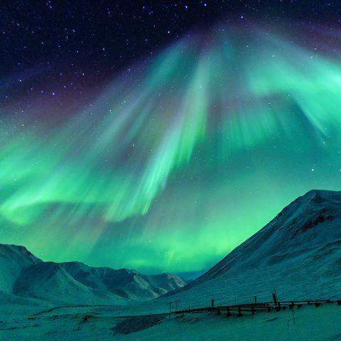 Aurora, Green, Natural environment, Natural landscape, Atmospheric phenomenon, Landscape, Slope, Highland, Hill, Space,