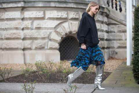 Sleeve, Textile, Outerwear, Style, Street fashion, Knee, Jacket, Pattern, Stone wall, Electric blue,