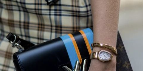 Wallet, Leather, Street fashion, Wrist, Fashion accessory, Tartan, Hand, Design, Coin purse, Pattern,