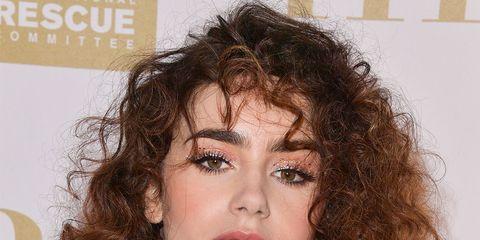 Hair, Face, Hairstyle, Eyebrow, Brown hair, Chin, Long hair, Layered hair, Lip, Beauty,