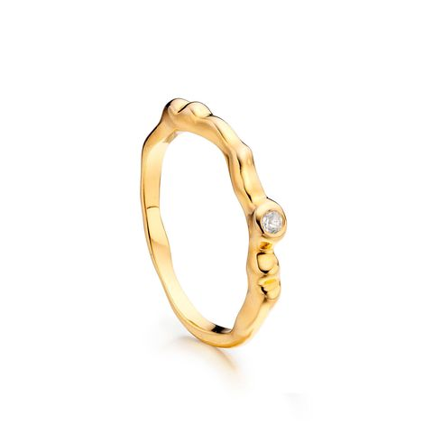 Jewellery, Fashion accessory, Ring, Amber, Body jewelry, Natural material, Tan, Metal, Beige, Gemstone,