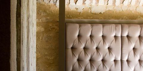 Room, Wall, Interior design, Linens, Fixture, Bed, Beige, Bedroom, Bedding, Door,