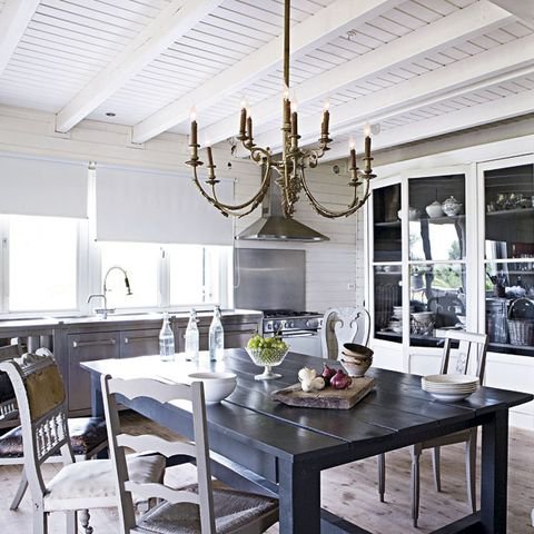 Room, Interior design, Table, Ceiling, Furniture, Light fixture, Chandelier, Ceiling fixture, Interior design, Candle holder,
