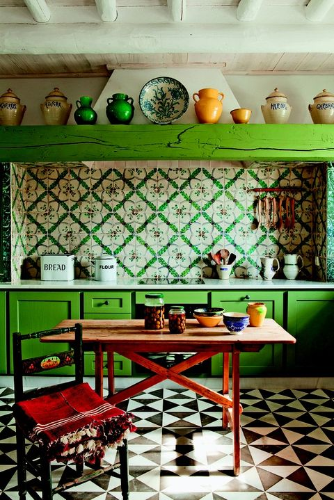 Green, Room, Interior design, Wall, Table, Interior design, Light fixture, Home accessories, Shelf, Tile,