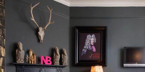 Wood, Room, Deer, Interior design, Furniture, Living room, Antler, Interior design, Natural material, Display device,