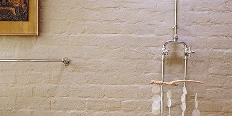 Wall, Room, Interior design, Interior design, Bathtub, Plumbing fixture, Picture frame, Material property, Brick, Plumbing,