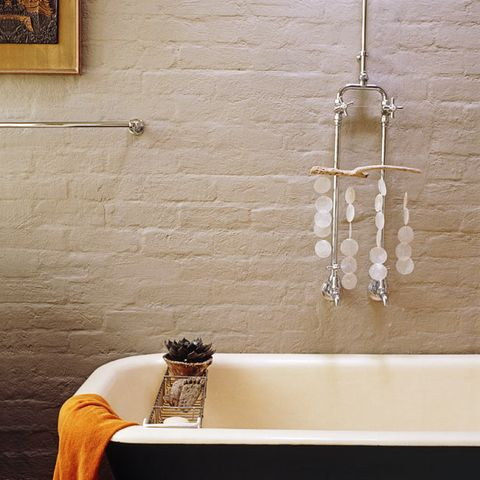Wall, Room, Interior design, Interior design, Bathtub, Plumbing fixture, Picture frame, Material property, Brick, Plumbing,