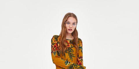 Clothing, Fashion model, Orange, Day dress, Yellow, Shoulder, Dress, Sleeve, Joint, Fashion,
