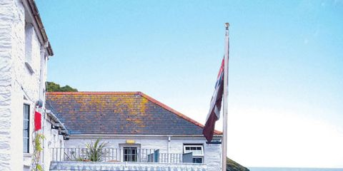 Window, Watercraft, House, Flowerpot, Building, Coastal and oceanic landforms, Real estate, Flag, Home, Stairs,