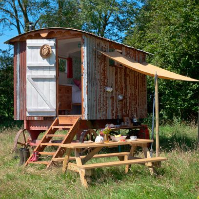 Wood, Rural area, Lumber, Plywood, Picnic table, Outdoor furniture, Outdoor table, Yard, Mobile home,