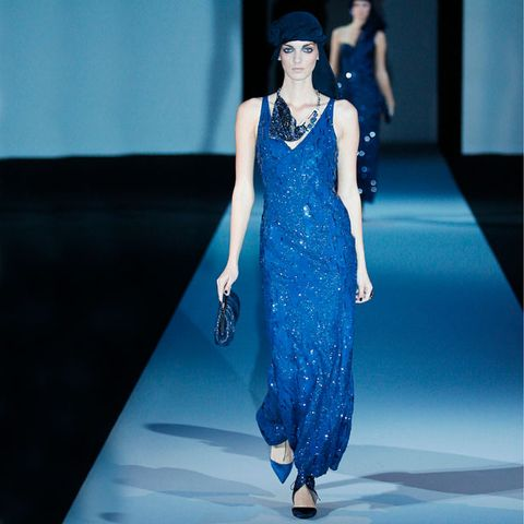 Blue, Fashion show, Shoulder, Dress, Joint, Runway, Style, Fashion model, Formal wear, Hat,