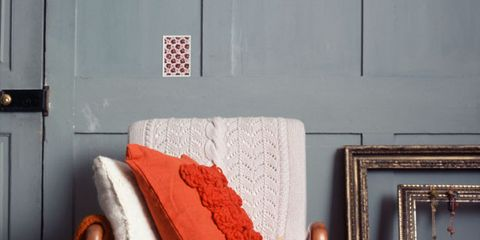 Furniture, Room, Bedroom, Couch, Orange, Interior design, Pillow, Living room, Bedding, Bed sheet,