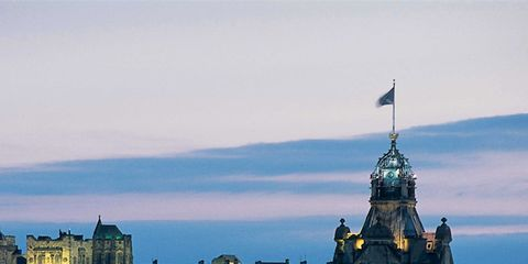 Sky, City, Town, Landmark, Flag, Facade, Roof, Finial, Turret, Medieval architecture,