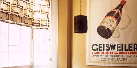Table, Bottle, Room, Furniture, Interior design, Glass bottle, Window covering, Logo, Drink, Hardwood,