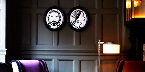 Lighting, Room, Interior design, Furniture, Floor, Chair, Purple, Living room, Interior design, Club chair,