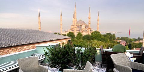 Spire, Furniture, Finial, Steeple, Roof, Place of worship, Outdoor furniture, Tower, Outdoor table, Wicker,