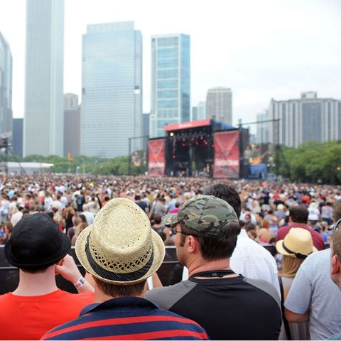Crowd, Hat, Daytime, People, Tower block, City, Urban area, Metropolitan area, Mammal, Building,