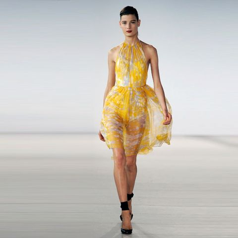 Clothing, Leg, Yellow, Fashion show, Human body, Shoulder, Dress, Human leg, Joint, One-piece garment,