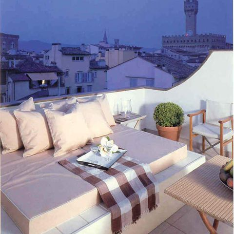 Furniture, Textile, Tablecloth, Table, Home, Linens, Real estate, Roof, Outdoor furniture, Pillow,