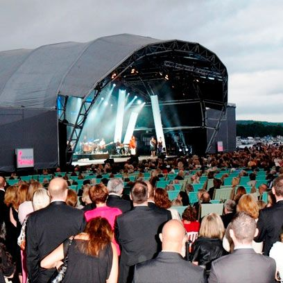 Hair, Crowd, Stage equipment, People, Entertainment, Audience, Stage, Music venue, Performance, Public event,