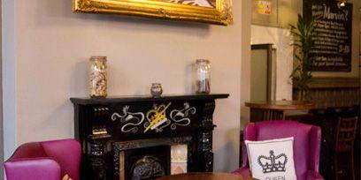 Room, Furniture, Picture frame, Purple, Magenta, Chair, Hardwood, Interior design, Wood stain, Velvet,