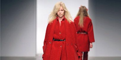 Clothing, Leg, Sleeve, Human body, Shoulder, Textile, Red, Joint, Coat, Outerwear,