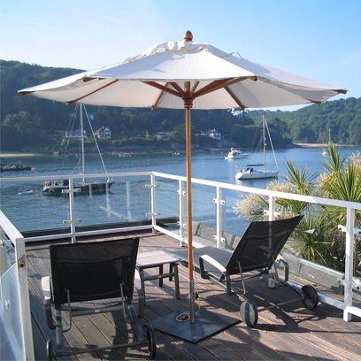 Outdoor furniture, Sunlounger, Shade, Watercraft, Umbrella, Outdoor table, Resort, Loch, Boat, Outdoor structure,
