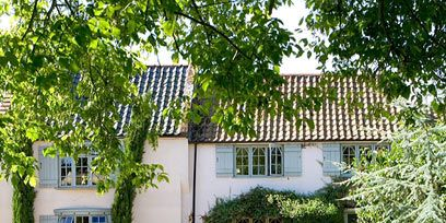Window, Flag, Property, Tree, Neighbourhood, House, Building, Door, Real estate, Residential area,