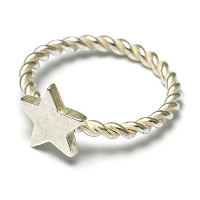 Jewellery, Fashion accessory, Metal, Body jewelry, Natural material, Chain, Silver, Circle, Symbol, Mineral,