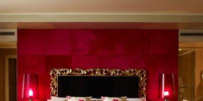 Bed, Lighting, Room, Interior design, Property, Bedding, Textile, Bedroom, Wall, Magenta,