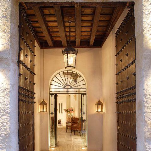 Lighting, Architecture, Interior design, Ceiling, Home door, Light fixture, Interior design, Arch, Door, Hall,