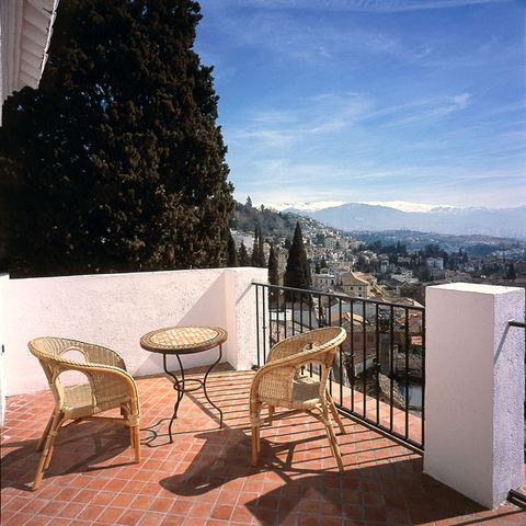 Outdoor furniture, Table, Real estate, Outdoor table, Coffee table, Mountain range, Patio, Shade, Balcony, Outdoor structure,