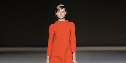 Sleeve, Shoulder, Fashion show, Joint, Style, Runway, Formal wear, Fashion model, Orange, Fashion,