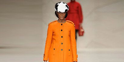 Sleeve, Textile, Joint, Outerwear, Bag, Style, Collar, Fashion accessory, Street fashion, Orange,
