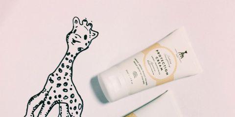 Drinkware, Beige, Giraffidae, Giraffe, Label, Bottle, Paper, Toy, Cosmetics, Brand,