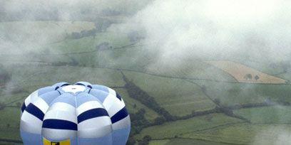 Nature, Daytime, Atmosphere, Logo, Atmospheric phenomenon, Aerostat, World, Balloon, Hot air ballooning, Hot air balloon,