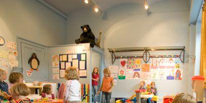 Arm, Lighting, Room, Interior design, Child, Sharing, Picture frame, Toddler, Light fixture, Kindergarten,