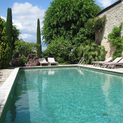 Swimming pool, Property, Water, Fluid, Real estate, Aqua, Azure, Shrub, Garden, Turquoise,