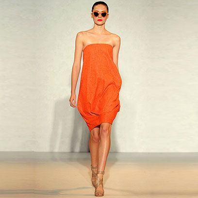 Human leg, Shoulder, Dress, Joint, One-piece garment, Style, Fashion model, Orange, Waist, Fashion,