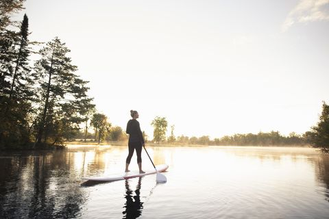Water, Photograph, Stand up paddle surfing, Sky, Reflection, Tree, Lake, Standing, River, Recreation,