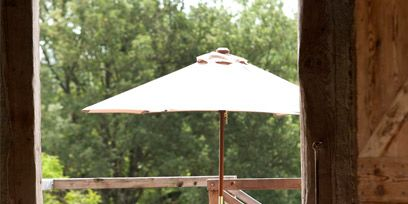 Wood, Hardwood, Chair, Shade, Outdoor furniture, Wood stain, Outdoor table, Outdoor structure, Wicker,