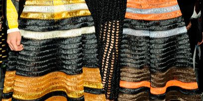 Clothing, Footwear, Leg, Brown, Human leg, Orange, Shoe, Textile, Joint, Pattern,