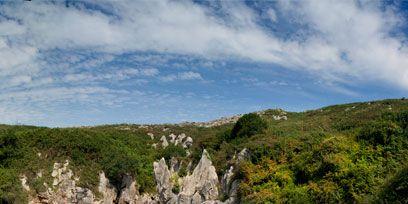 Beach, Sky, Natural landscape, Coast, Sand, Tourism, Vacation, Wilderness, Sea, Rock,