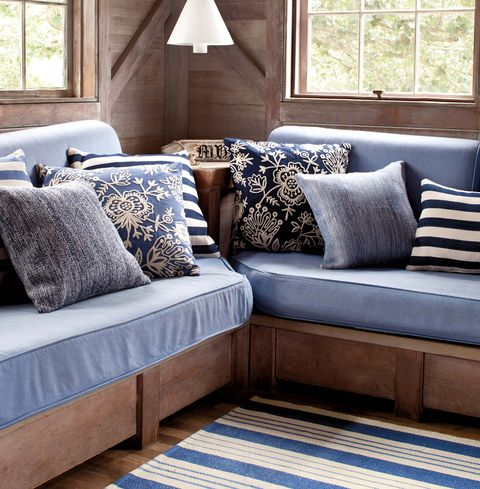 Furniture, Blue, Room, Couch, Bedding, Living room, Interior design, studio couch, Pillow, Floor,