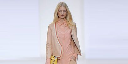 Clothing, Hairstyle, Skin, Sleeve, Human leg, Shoulder, Joint, Standing, Style, Peach,