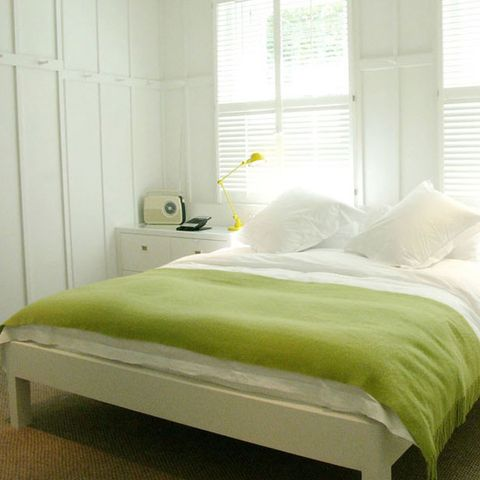 Room, Bed, Interior design, Yellow, Property, Textile, Bedding, Wall, Bedroom, Linens,