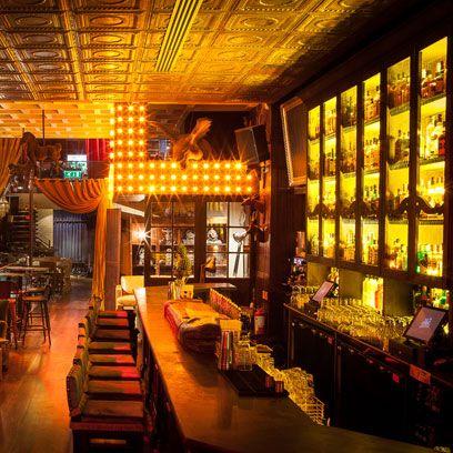 Lighting, Interior design, Ceiling, Restaurant, Interior design, Light fixture, Houseplant, Drinking establishment, Couch, Bar,