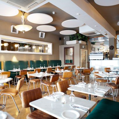 Lighting, Room, Interior design, Furniture, Restaurant, Ceiling, Table, Dishware, Light fixture, Chair,